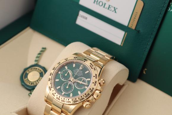 Rolex Daytona Yellowgold unworn green